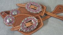 Custom spur straps light oil with pink oval buckles and conchos